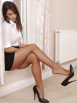 Sexy babe Sofia arrives home from the office wearing a white blouse, short skirt, black stockings and high heels