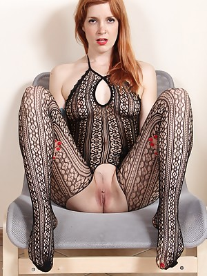 Irina Vega shows her feet in catsuit