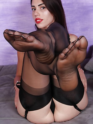 Beautiful Petra shows her flawless soles in sexy nylons