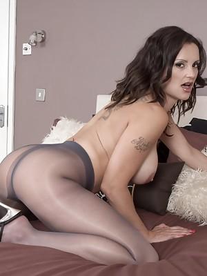 Slinky Val dildo sex in her glossy grey pantyhose
