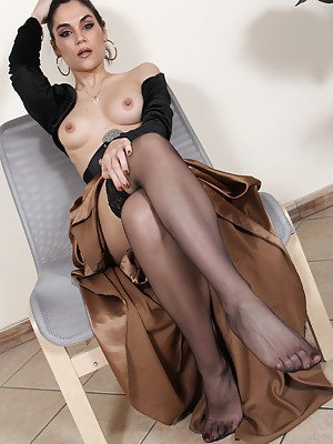 Stunning brunette in sexy nylons shows off her perfect feet