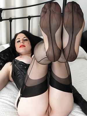 Your busty leather and nylon mistress wants your tongue
