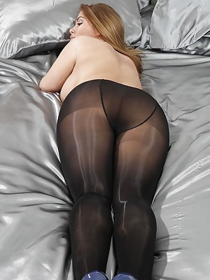 Siobhan Graves in blue with black glossy tights