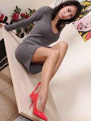 Hot brunette shows her perfect feet in sexy nylons