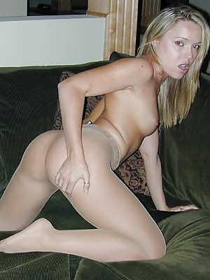 Sexy Trisha Uptown sits on her couch and gives you sweet shots of her legs in sheer crotch nude pantyhose.