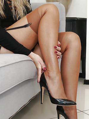 Gorgeous blonde Kathryn teases in shiny nylon stockings and sexy black patent stiletto heels