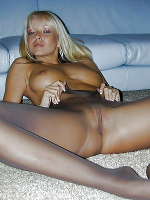 In a black body suit and black pantyhose, Jana Cova towers over you,